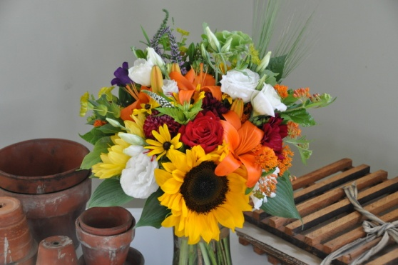 sunflowers, lilies, butterfly weed, lisianthus